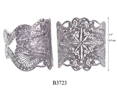 B3723: 320.00, OXI CUFF BRACELET FILIGREE STAR FLOWER IN CENTER.