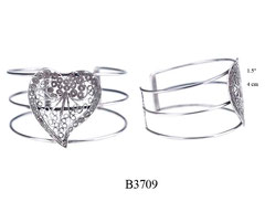 B3709: 180.00, OXI 3 BAND CUFF BRACELET WITH FILIGREE HEART DESIGN IN THE CENTER.
