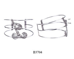 B3704: 170.00, OXI 3 BAND CUFF BRACELET WITH FILIGREE DESIGN IN THE CENTER.