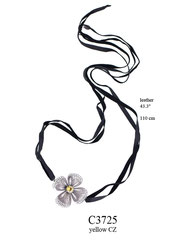C3725: 110.00, OXI NECKLACE HAND CUT BLACK LEATHER, FILIGREE FLOWER W/ A YELLOW CZ IN THE CENTER.