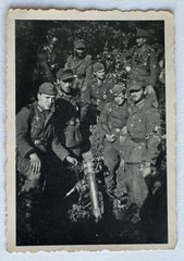 Walter (2nd from left with field cap and beard) and his mortar squad around Belfort, November 1944 (Photo courtesy Family Roland Laich)