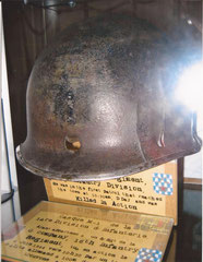 This helmet belonged to a S/Sgt. Of G Company, 16th Infantry Regiment. He was killed by a German sniper around 10.30 a.m. on June 6, 1944 near the new hotel, which is located at the roundabout which leads to the US Cemetery.