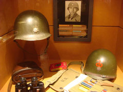 This helmet belonged to Major Elmer Schmierer. His command post was in Krinkelt were heavy fighting took place