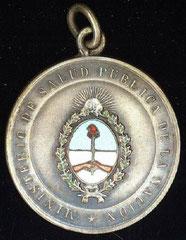 7. Frente Medalla Conmemorativa de la Primera Conferencia Nacional de la Enfermedad de Chagas, del 25 al 27 de Junio de 1953.