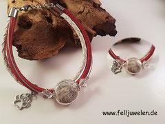 Bild 5: Glasperle 16mm gefüllt mit Tierhaar und verschiedenen Lederbändern nach Wunschfarbe. Angebracht ist eine Pfote aus 925er Silber. Verschluss aus Edelstahl. Preis: 52 Euro