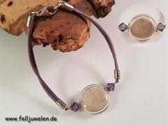 Bild 10: Fellhaare in eine flache Glasperle eingebunden und mit Swarovskisteinchen umschlossen. Lederband farblich abgestimmt. Preis: 32 Euro