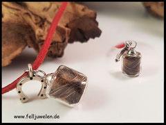 Bild 29: Glaswürfel (15mmx16mm) gefüllt mit Pferdehaar, als Symbol ist ein silbernes Hufeisen angebracht. Verschlossen it einer 925er Silberkappe. Preis: 32 Euro Band auf Anfrage.