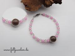 Bild 17: Glasperle in 16mm gefüllt mit Tierhaaren, klare Crackelperlen und rose farbige Polarisperlen mit einem Verschluss aus Edelstahl. Preis: 43 Euro