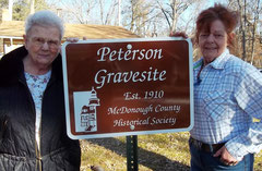 Bernadine Gustafson (left) mentioned this grave site on her daughter's property. Ann Hiland on the right accepts the new sign.