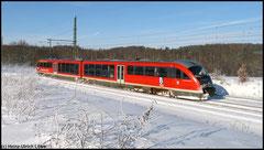 """""""Thermalbad Wiesenbad"""" der Erzgebirgsbahn rauscht am 18.12.2010 in Richtung Cranzahl."""