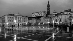 Der Tartini Platz - besonders fotogen bei beginnender Dämmerung und leichtem Regen