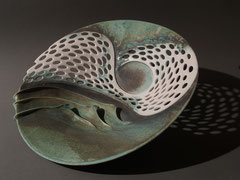 Large holed bowl in porcelain with waves and swirls