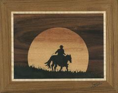 Un cow-boy au coucher du soleil (260/205)