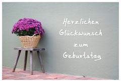 Bildnr. 158 / Geburtstag Blume auf Hocker