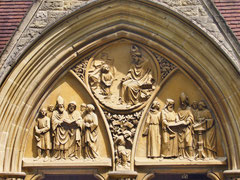 Scenes from the life of St Augustine over the porch door - image on Wikimedia by Tanya Dedyukhina