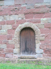 The door originally stood opposite the south door at the west end of the building.