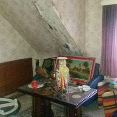 Slaapkamer voor de renovatie werken