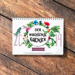 Der Wachsende Kalender 2019 Tausendsassa mit einpflanzbarem Samenpapier, illustriert von mir. Der Titel ist eine farbenfrohe Komposition verschiedener Pflanzen, die per Hand mit Aquarellfarbe illustriert sind.