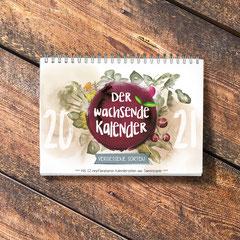 Der Wachsende Kalender 2021 Vergessene Sorten mit einpflanzbarem Samenpapier, illustriert von mir. Der Titel ist eine farbenfrohe Komposition verschiedener Pflanzen, die per Hand mit Aquarellfarbe illustriert sind.