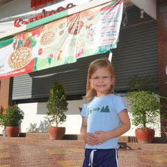 den Pizzaladen