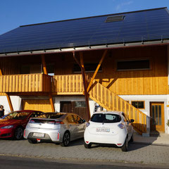 Our guests can charge their electric car at our home - straight from the sun. On the picture: TESLA - AMPERA - ZOE