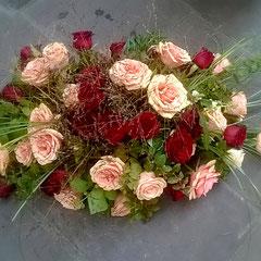 Raquette deuil de roses      100 euros