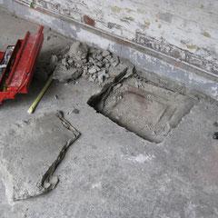 Du béton recouvrait une chambre de visite déjà affaissée ! L'acheteur de l'immeuble l'ignorait.