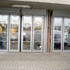 Falttore Wiek Tore Mönchengadbach Sektionaltore Garagentore Industrietore Rolltore  Reparaturen UVV-Prüfung Wartung
