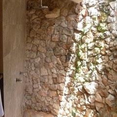 half open rock bathroom