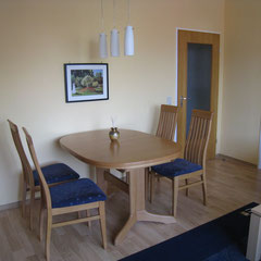 Large extendible dining table with chairs