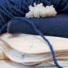 Strickwolle, Wohndecke und Zudecke aus Schafschurwolle