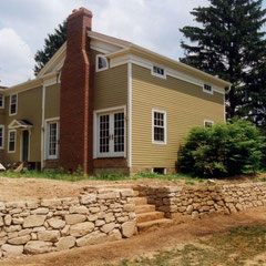 Construction complete; wall built to match Western Reserve style of architecture of residence.