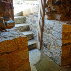 Cellar entry cheekwalls complete.  Recycled, load-bearing sandstone walls to match existing stone foundation.