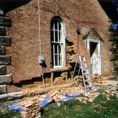Removal of cement patching and damaged brick from 1870-era schoolhouse to be converted into artist's studio, Tuscarawas County, OH.