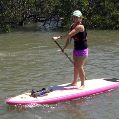 Kimberly carving up the water nicely on the C4 Waterman Wahini SUP!