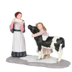 601523-Dorine and Elena feeding cow
