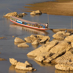 Laos, Luang Prabang: a water taxi on the Mekong River at sunset