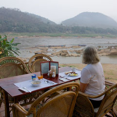 Laos, Luang Prabang: Breakfast on the dining terrace of the Mekong Riverview hotel