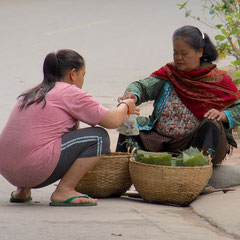 Laos, Luang Prabang: a food vendor outside Mekong Riverview hotel