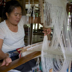 Laos, Luang Prabang: a weaver at Ock Pop Tok textile 'factory'