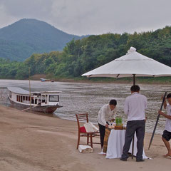 Laos, Luang Prabang: preparing a picnic on a sandbank in the Mekong River en route to the Pak Ou Caves