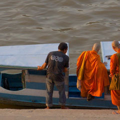 Laos, Luang Prabang: monks boarding a water taxi