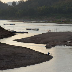 Laos, Luang Prabang: the Nam Khan river at its junction with the Mekong