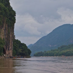 Laos, Luang Prabang: approaching Pak Ou Caves in the rock face on left (about 25 km upstream from Luang Prabang)