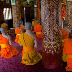 Laos, Luang Prabang: monks praying at Wat Si Boun Houang