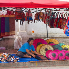 Laos, Luang Prabang: setting up a stall at the night market on Sisavangvong Street