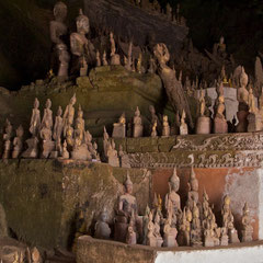 Laos, Pak Ou: isome of the many offerings left in Tham Thing (the lower cave)