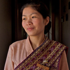 Laos, Luang Prabang, La Residence Phou Vao: portrait of Touy noy (the hotel's cashier)