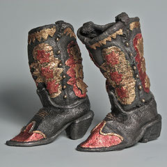 Star Boots, cast iron, gold leaf, metal dye; ladies size 6