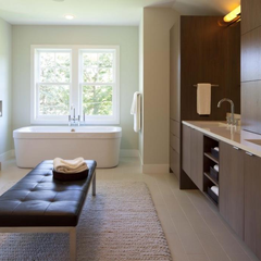 Sydney bathroom renovations A bathroom large enough to be a room with extensive cabinetry and storage.